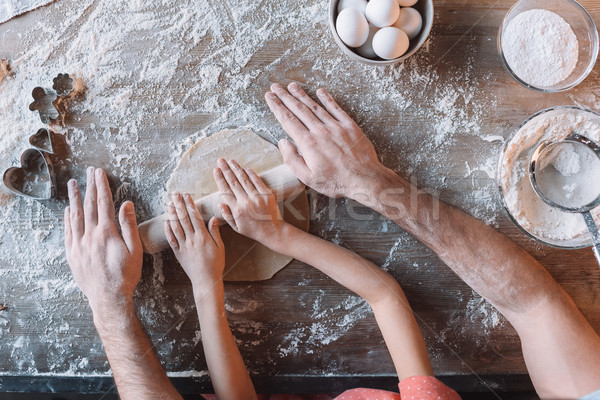 'Partial top view of father and daughter kneading dough together Stock photo © LightFieldStudios