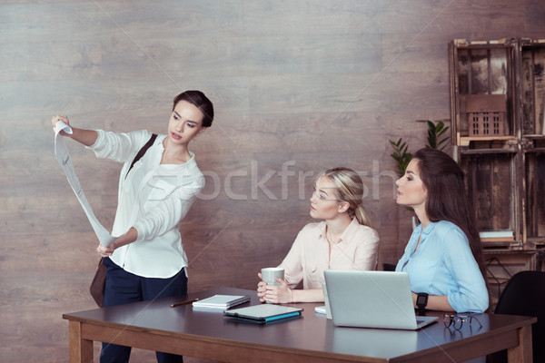 architect showing blueprint to colleagues in office Stock photo © LightFieldStudios