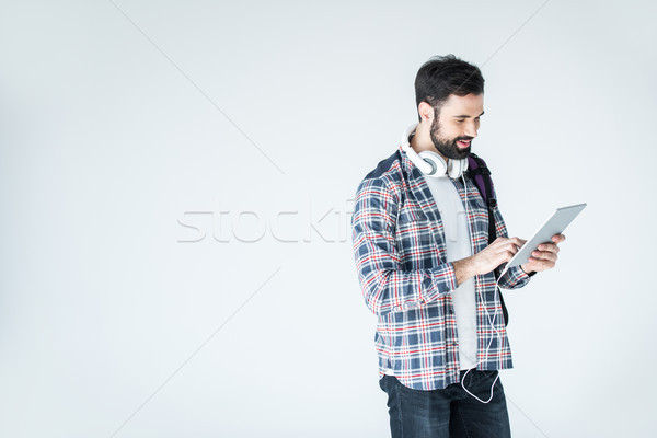 bearded man with headphones and digital tablet on white with copy space Stock photo © LightFieldStudios