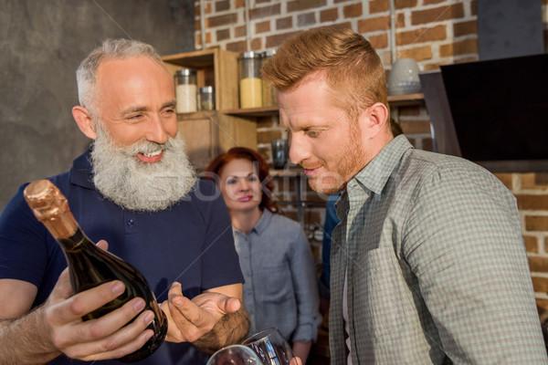 men discussing wine Stock photo © LightFieldStudios