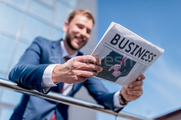 Stock photo: businessman with business newspaper