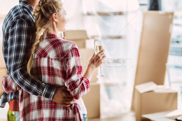Pár iszik pezsgő új ház lövés fiatal pér Stock fotó © LightFieldStudios