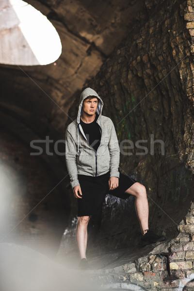 young man in hoodie Stock photo © LightFieldStudios