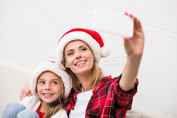 Stock photo: mother and daughter taking selfie