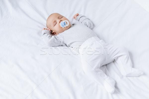 baby sleeping on bed Stock photo © LightFieldStudios