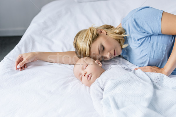 mother and baby sleeping together Stock photo © LightFieldStudios