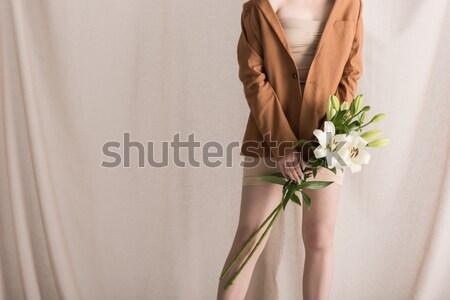 Nő tart virágcsokor virágok kilátás kezek Stock fotó © LightFieldStudios