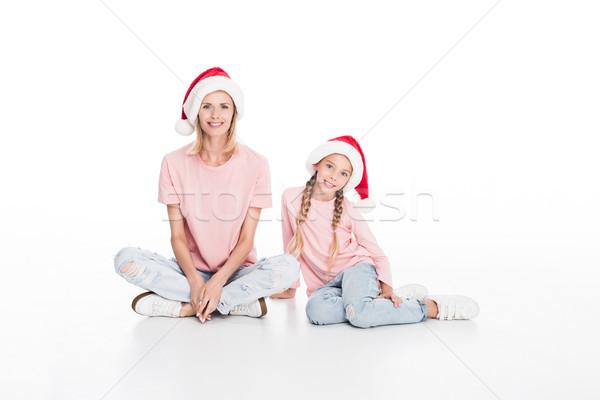 mother and daughter in santa hats Stock photo © LightFieldStudios