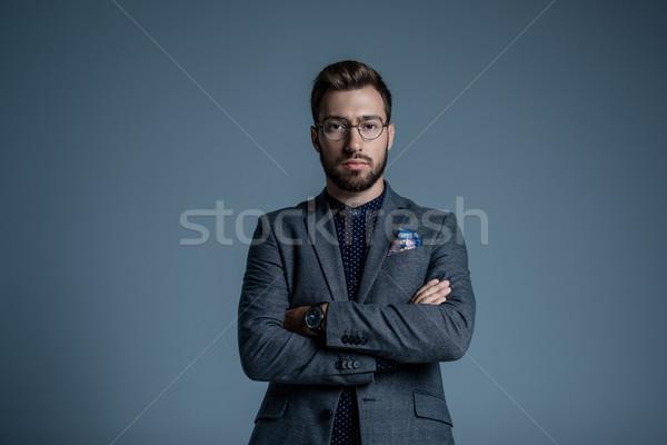 üzletember keresztbe tett kar fiatal jóképű hivatalos öltöny Stock fotó © LightFieldStudios