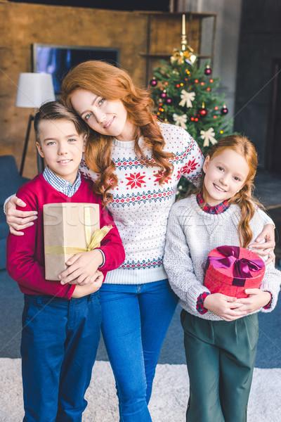 mother embracing with kids on christmas Stock photo © LightFieldStudios