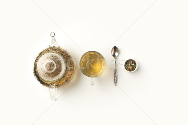 Stock photo: herbal tea in cup and kettle