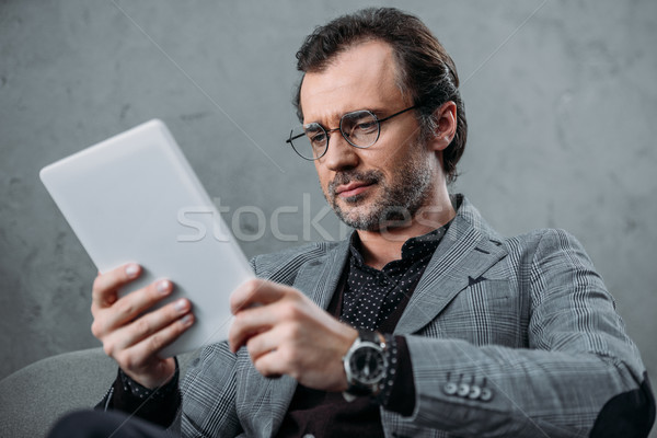 Stock photo: businessman using digital tablet