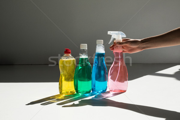 human hand and cleaning fluids Stock photo © LightFieldStudios