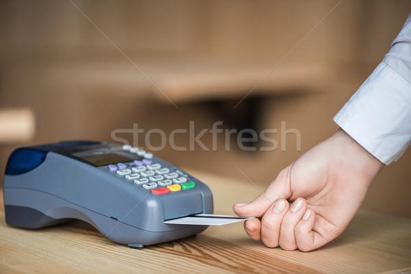 putting credit card into terminal Stock photo © LightFieldStudios
