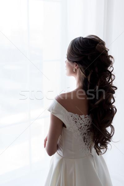 Hátulnézet menyasszony esküvői ruha néz ablak esküvő Stock fotó © LightFieldStudios