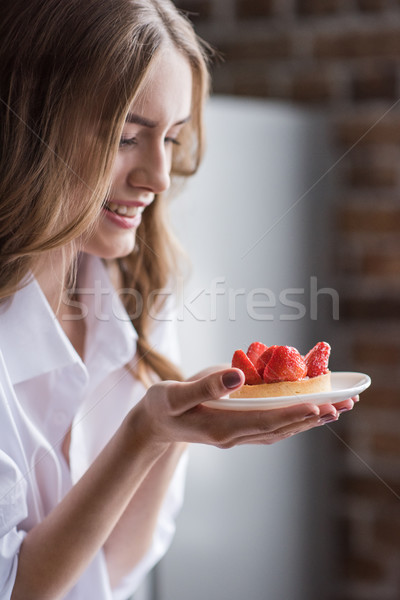Woman with strawberry cake  Stock photo © LightFieldStudios