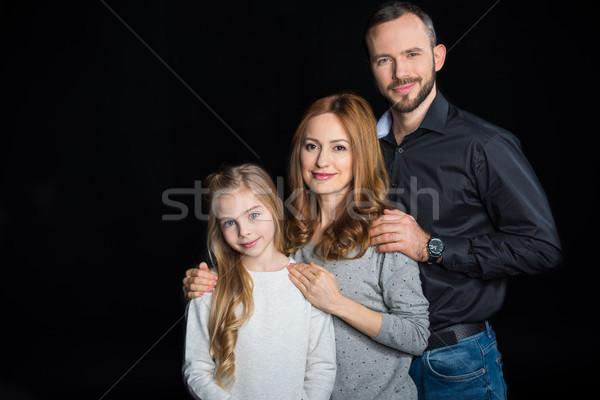Happy family standing together Stock photo © LightFieldStudios