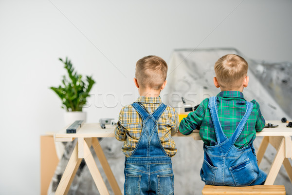Little boys in workshop Stock photo © LightFieldStudios
