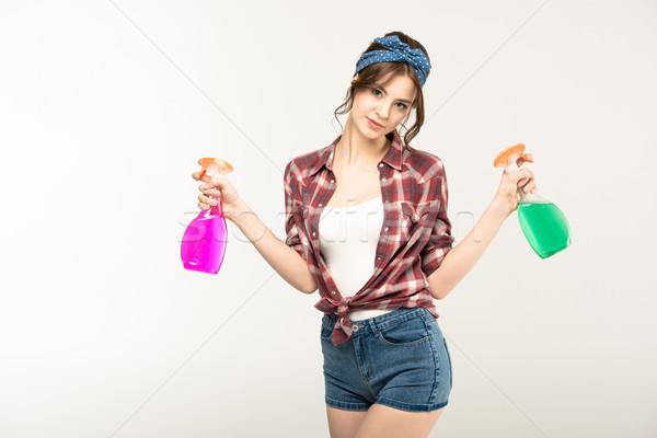 Genç kadın sprey şişeler çekici bakıyor Stok fotoğraf © LightFieldStudios