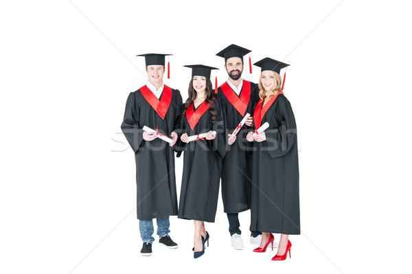 Vue heureux élèves graduation Photo stock © LightFieldStudios