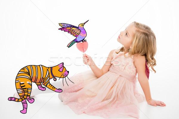 Cute dziewczynka lizak posiedzenia kot Zdjęcia stock © LightFieldStudios