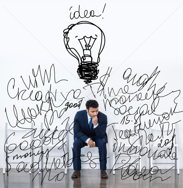 Stock photo: businessman sitting on chair