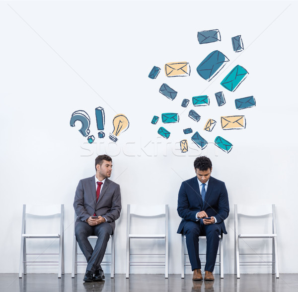 businessmen sitting on chairs Stock photo © LightFieldStudios
