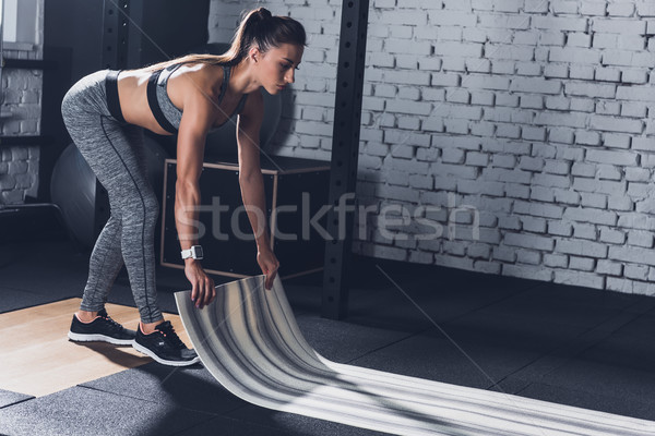 sportive woman with mat Stock photo © LightFieldStudios