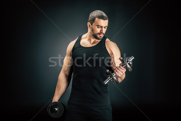 sportive man pumping muscles Stock photo © LightFieldStudios
