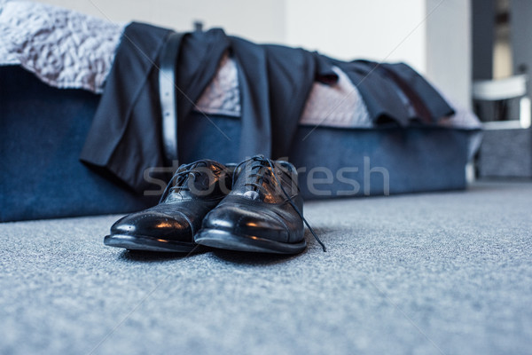 Formal attire on bed and leather shoes Stock photo © LightFieldStudios