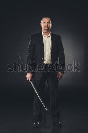 Homme costume posant skateboard sophistiqué jeune homme Photo stock © LightFieldStudios