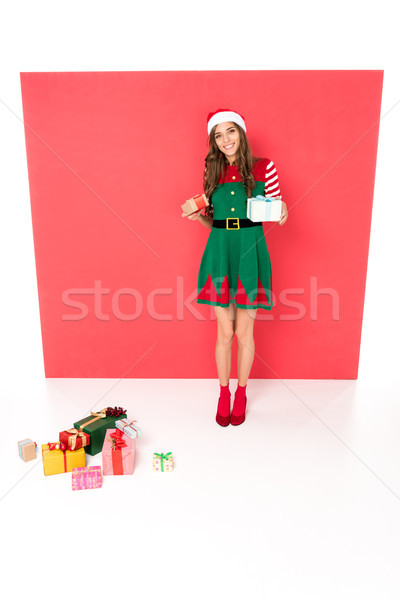 woman in christmas costume with gifts Stock photo © LightFieldStudios