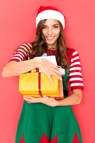 woman in elf costume with presents Stock photo © LightFieldStudios
