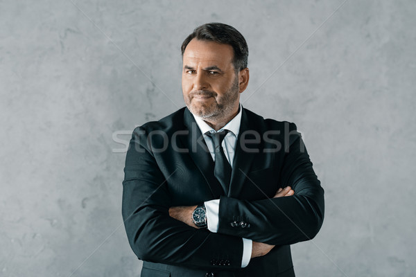 businessman with crossed arms Stock photo © LightFieldStudios