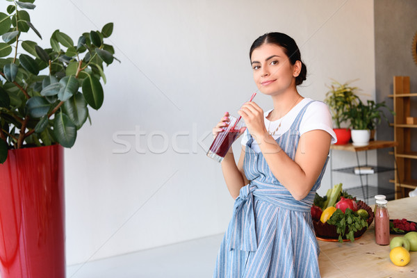 young woman with glass of detox drink Stock photo © LightFieldStudios