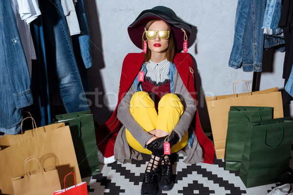 woman in clothes with sale tags Stock photo © LightFieldStudios