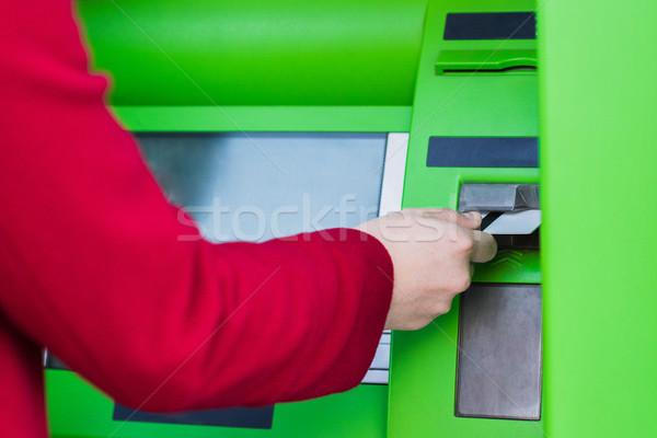 putting credit card into atm Stock photo © LightFieldStudios