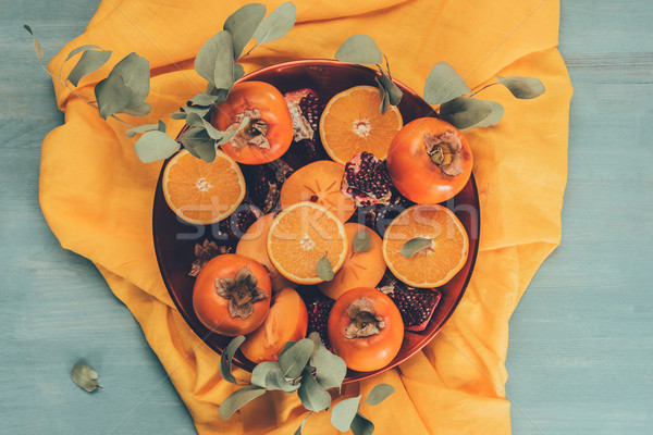 top view of fruits on plate on orange tablecloth Stock photo © LightFieldStudios