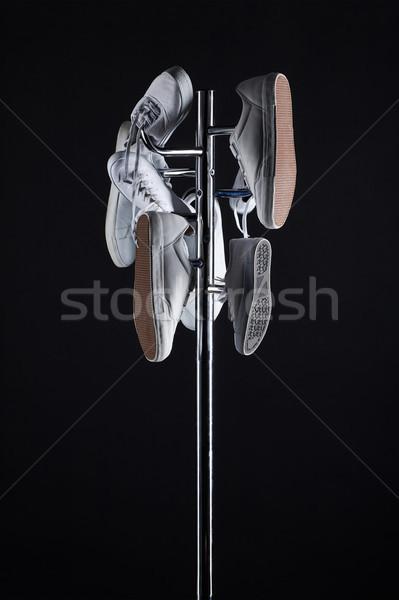 Chaussures suspendu manteau rack noir Photo stock © LightFieldStudios