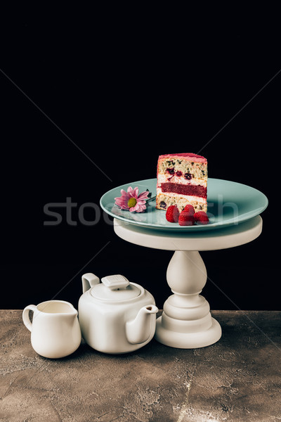 delicious cake with raspberries and flower and kettle with porcelain jug on black Stock photo © LightFieldStudios