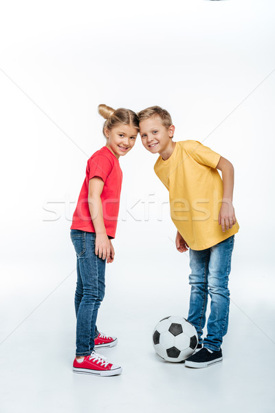 siblings standing with soccer ball Stock photo © LightFieldStudios