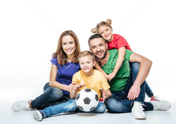 Happy family with soccer ball Stock photo © LightFieldStudios