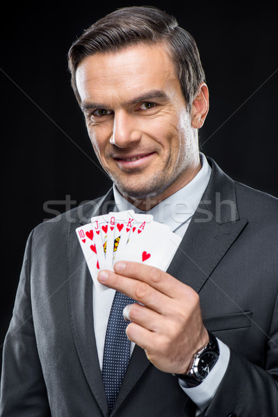 Man holding playing cards  Stock photo © LightFieldStudios