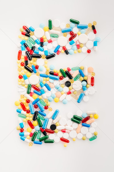 Top view of letter E made from medical pills and capsules, medicine and healthcare concept Stock photo © LightFieldStudios