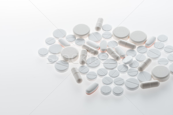 Close-up view of medical pills and capsules on white, medicine and healthcare concept       Stock photo © LightFieldStudios