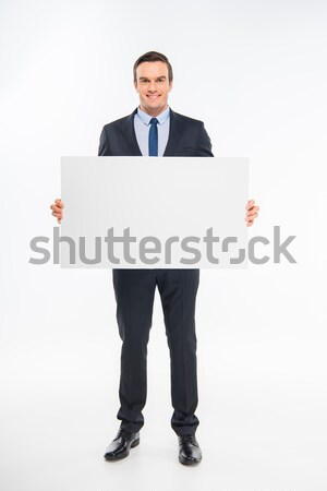 Businessman holding blank card Stock photo © LightFieldStudios
