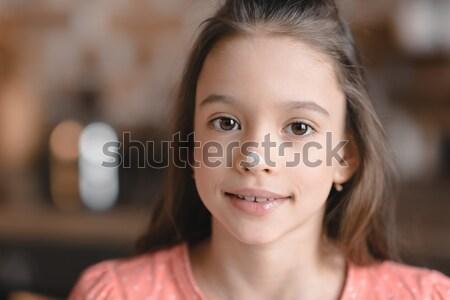 Sevimli küçük kız un burun gülen kamera Stok fotoğraf © LightFieldStudios
