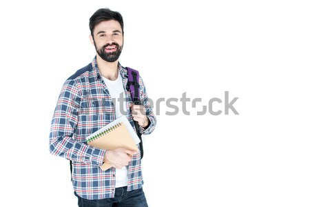 bearded student holding copybooks isolated on white wth copy space Stock photo © LightFieldStudios