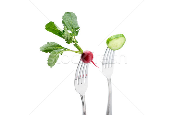 cucumber and radish on forks isolated on white. healthy lifestyle concept Stock photo © LightFieldStudios