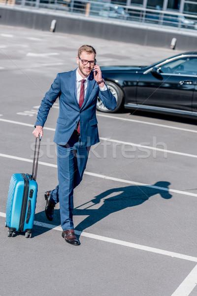 üzletember bőrönd utazás öltöny üzleti út városi Stock fotó © LightFieldStudios